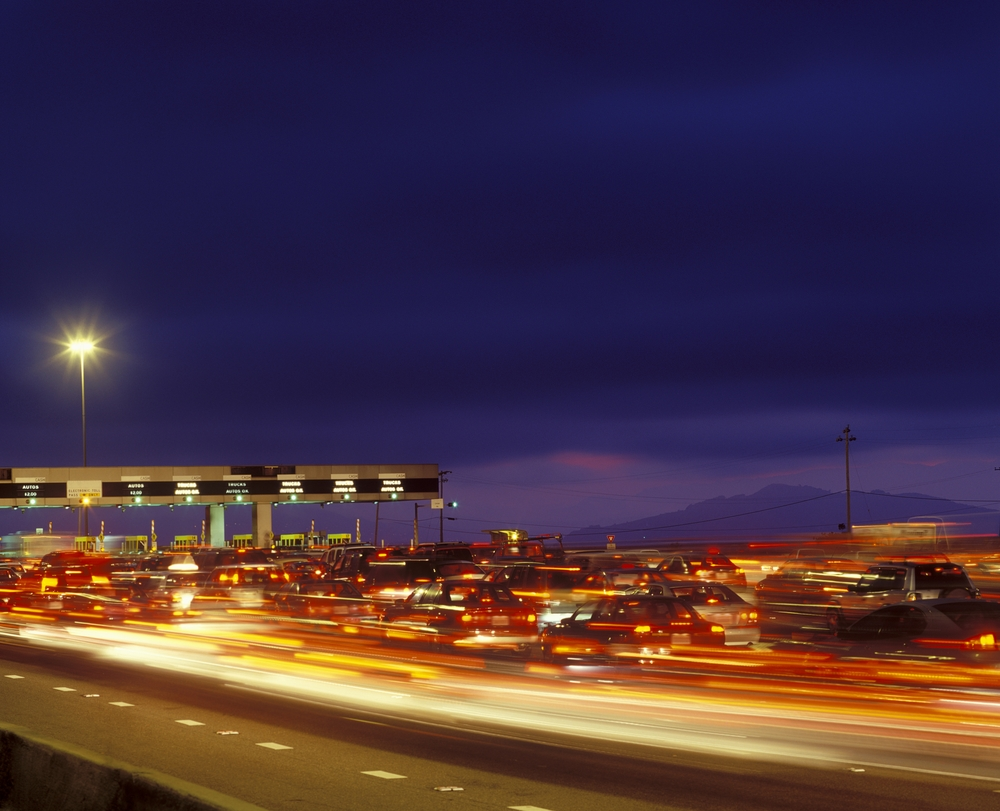 Cars passing under a toll booth in California.